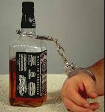 foto bottiglia-manette